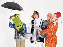 Funny Characters. Theatrical actors in different characters of crocodile, landlord, spacewoman and a sultan Stock Photography