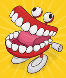 Funny Chattering Teeth Toy with Jiggly Eyes , Vector Illustration. Funny chattering teeth toy with googly eyes and feet  in yellow background Stock Images