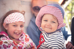 Funny cheerful baby with family outdoors symbolizing happiness Royalty Free Stock Photos