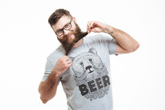 Funny cheerful bearded man standing and having fun Stock Images