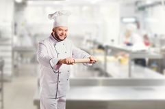 Funny cheerful chef in white uniform on a background. stock images