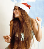 Funny cheerful girl in santa red hat and bikini isolated Royalty Free Stock Photos