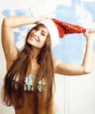 Funny cheerful girl in santa red hat and bikini isolated Stock Photo