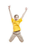 Funny cheerful little child jumping and laughing Stock Image