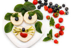 Funny cheesecakes on plate look like animal. Dessert for kids, on white background Stock Photo