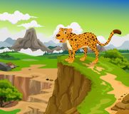 Funny Cheetah cartoon with mountain landscape background Stock Image