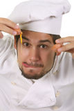 Funny chef cracking an egg Stock Image
