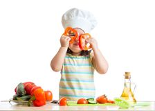 Funny chef girl cooking at kitchen Royalty Free Stock Image