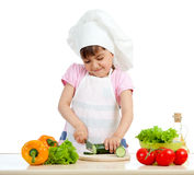 Funny chef girl preparing healthy food Stock Photos