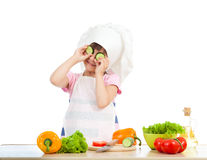 Funny chef girl preparing healthy food Royalty Free Stock Images