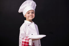 Funny chef. Keeps a white clean plate Royalty Free Stock Images