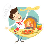 Funny chef preparing pizza dish in the kitchen Stock Images