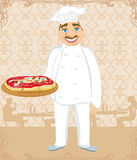 Funny chef serves pizza in a restaurant Royalty Free Stock Photography
