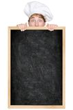 Funny chef showing blackboard menu sign. Funny chef showing blank empty blackboard menu sign for restaurant menu or recipe. Man chef cook or baker hiding behind royalty free stock photos