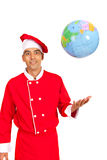 Funny chef throwing world globe Royalty Free Stock Photography
