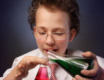 Funny chemist with two flasks Royalty Free Stock Photography