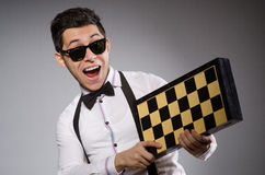 Funny chess player. With board Royalty Free Stock Photography
