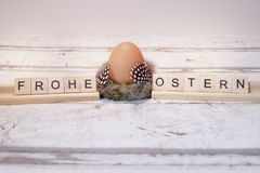 Easter egg with wooden letter,frohe ostern royalty free stock photography