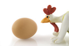 Funny chicken. Brown egg with funny chicken Stock Image