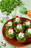 Funny chickens from eggs on the Easter table Royalty Free Stock Photos