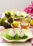 Funny chickens from eggs. Funny chickens from eggs on the Easter table stock photo