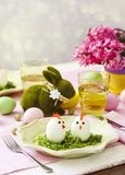 Funny chickens from eggs on the Easter table. Easter table setting royalty free stock photos