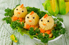 Funny chickens from eggs on the Easter table Royalty Free Stock Photography