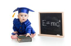 Funny child in academician clothes at chalkboard Royalty Free Stock Photo