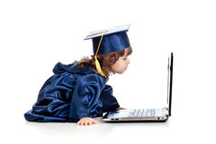 Funny child as academic using laptop Stock Photo