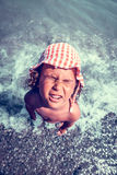 Funny child on the beach Stock Photo
