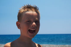 Funny child on the beach.smiling little boy.sea Royalty Free Stock Photography