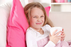 Funny child in the bed Royalty Free Stock Photos