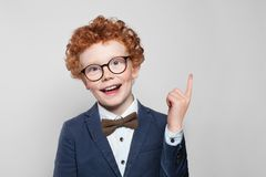 Funny child boy pointing up.  stock image