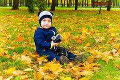 Funny child with a camera Stock Photography