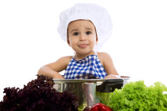 Funny child chef in pot with vegetables Royalty Free Stock Photos