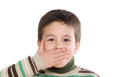 Funny child covering his mouth Royalty Free Stock Photos