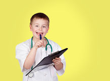 Funny child with doctor uniform Royalty Free Stock Photo
