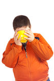 Funny child drinking from big yellow cup Royalty Free Stock Images