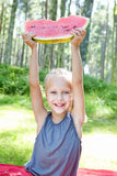 Funny child eating watermelon in the park Stock Image