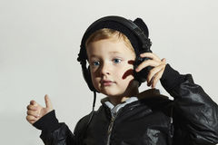Funny child enjoy music. Little boy in headphones Stock Photography