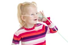 Funny child in eyeglasses with can isolated on. Funny child in eyeglasses using a can as a telephone isolated on white Stock Image