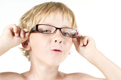 Funny child in eyeglasses. Close up portrait Stock Photography