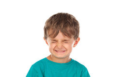 Funny child with eyes closed. Isolated on a white background stock image