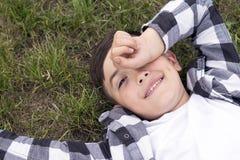 Funny child falling asleep outdoors stock photos