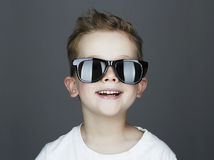 Funny child.fashionable little boy in sunglasses. Smiling Funny child.fashionable little boy in sunglasses stock image