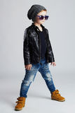 Funny child.fashionable little boy in sunglasses.stylish kid in yellow shoes Stock Photography