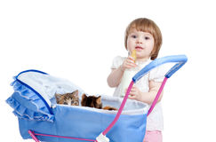 Funny child feeding attractive kitten from bottle Royalty Free Stock Photo