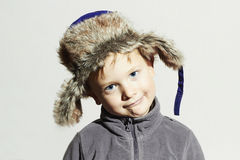 Funny child in fur Hat.fashion casual winter style.little boy.children emotion Stock Photos