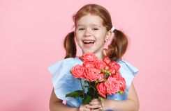 Funny child girl with bouquet of flowers on colored background Stock Image