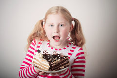Funny Child girl with cake Stock Photo